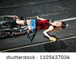 a girl fallen off a bicycle and ... | Shutterstock . vector #1105637036