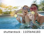 girl friends in swimming pool ... | Shutterstock . vector #1105646183