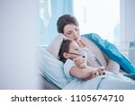 mother taking care of sick... | Shutterstock . vector #1105674710