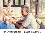 seniors enjoying breakfast | Shutterstock . vector #1105683980