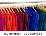 row of female colorful clothes... | Shutterstock . vector #1105684556