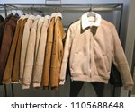 clothes with row of jacket ... | Shutterstock . vector #1105688648