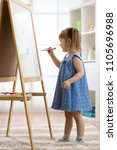 kid girl drawing on white board ... | Shutterstock . vector #1105696988
