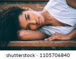 beautiful young black woman... | Shutterstock . vector #1105706840