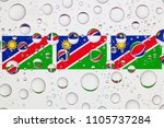 flags of namibia behind a glass ... | Shutterstock . vector #1105737284