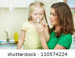 little girl drinking water in... | Shutterstock . vector #110574224