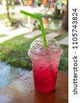 Small photo of Red soda cold thirst in garden.