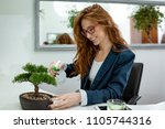 young business woman working in ... | Shutterstock . vector #1105744316