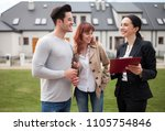 real estate agent talking with... | Shutterstock . vector #1105754846