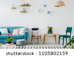 blue couch next to a wooden... | Shutterstock . vector #1105802159
