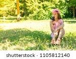 little girl eating chocolate... | Shutterstock . vector #1105812140