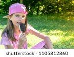 little girl eating ice cream... | Shutterstock . vector #1105812860