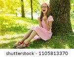 laughing girl hold lollipop... | Shutterstock . vector #1105813370