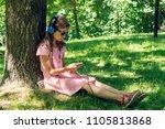 girl listening to music under... | Shutterstock . vector #1105813868