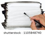 hand holding paintbrush and... | Shutterstock . vector #1105848740