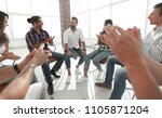creative team applauding the... | Shutterstock . vector #1105871204