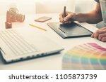 graphic designer at work in... | Shutterstock . vector #1105873739