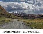 road through a dry desert... | Shutterstock . vector #1105906268