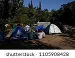 refugees and migrants rest in... | Shutterstock . vector #1105908428