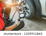 close up mechanic inflating... | Shutterstock . vector #1105911863