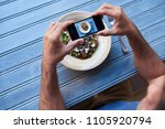 man sitting at a bistro table...   Shutterstock . vector #1105920794