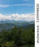 Small photo of Scenic view of green mountains against blue cloudy sky. San Leonardo, Udine, Friuli Venezia Giulia. Italy.