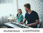 single father plays on... | Shutterstock . vector #1105955450