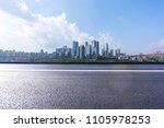city skyline with empty road in ... | Shutterstock . vector #1105978253
