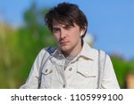 young handsome man wearing... | Shutterstock . vector #1105999100