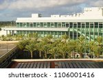 Modern architecture of convention center in California surrounded by palm trees.