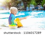 baby with toy boat in swimming...   Shutterstock . vector #1106017289
