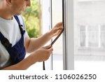 construction worker putting... | Shutterstock . vector #1106026250
