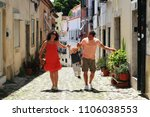 lisbon portugal  a young family ... | Shutterstock . vector #1106038553