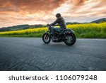 man riding sportster motorcycle ... | Shutterstock . vector #1106079248