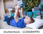 happy emotional six years boy... | Shutterstock . vector #1106084990