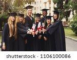 group of multiethnic graduate... | Shutterstock . vector #1106100086