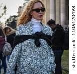 Small photo of PARIS, France- March 03 2018:Elina Halimi on the street during the Paris Fashion Week