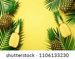 pineapples and tropical palm... | Shutterstock . vector #1106133230