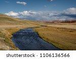 desert steppe river valley on a ... | Shutterstock . vector #1106136566
