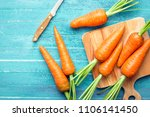 Carrots On A Blue Wooden...