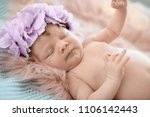 adorable newborn baby girl with ... | Shutterstock . vector #1106142443