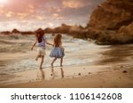 two sisters holding hands and... | Shutterstock . vector #1106142608