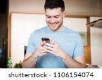 handsome young happy man using... | Shutterstock . vector #1106154074