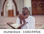 black african muslim man is... | Shutterstock . vector #1106154926