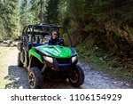 a tour group travels on atvs... | Shutterstock . vector #1106154929