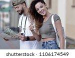 happy  tourists taking a walk... | Shutterstock . vector #1106174549