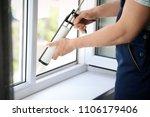 construction worker sealing... | Shutterstock . vector #1106179406