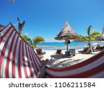 woman relaxing and sunbathing... | Shutterstock . vector #1106211584