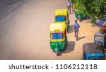Small photo of New Delhi / India - April 14 2017: Yellow auto rickshaws on a busy and polluted highway / motorway in New Delhi called the Outer Ring with many cars and auto rickshaws during the day in India.
