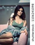 sexy tattooed woman model... | Shutterstock . vector #1106241098